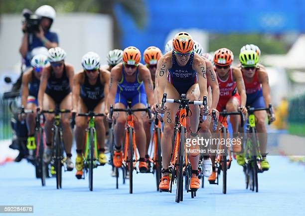 Gwen Jorgensen of the United States leads the group as she rides during the Women's Triathlon on Day 15 of the Rio 2016 Olympic Games at Fort...