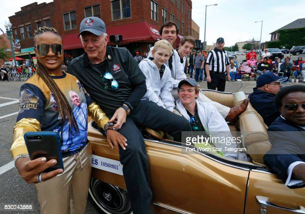 Gwen Morris wearing a Jerry Jones shirt was called by Jones to his car so she could make a selfie with him and his grandsons The 2017 NFL Hall of...