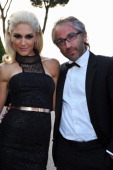 Gwen Stefani and L'Oreal Paris Global President Cyril Chapuy attend amfAR's Cinema Against AIDS Gala during the 64th Annual Cannes Film Festival at...