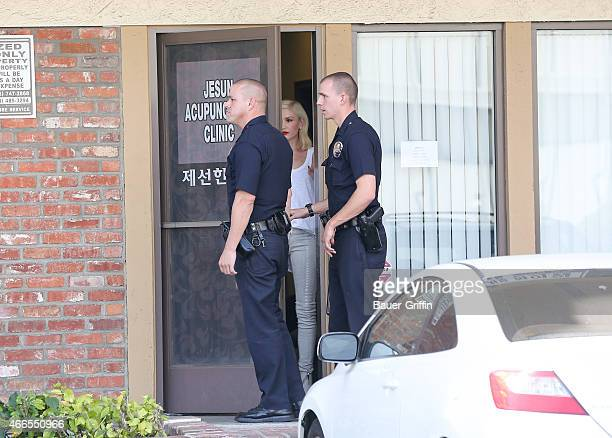 Gwen Stefani and Los Angeles Police officers are seen in Los Angeles at the Jesun Acupuncture clinic on March 16 2015 in Los Angeles California