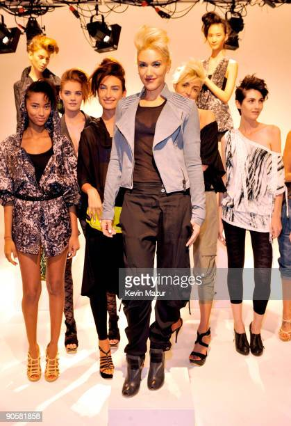 Gwen Stefani and models pose during the LAMB Fashion Presentation at the MAC and Milk Studio on September 10 2009 in New York City