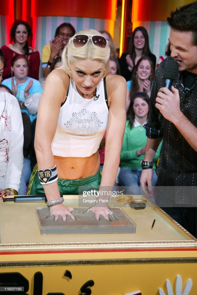Gwen Stefani and MTV's Damien Fahey during Sandra Bullock and Gwen Stefani Visit MTV's 'TRL' March 22 2005 at MTV Studios Times Square in New York...