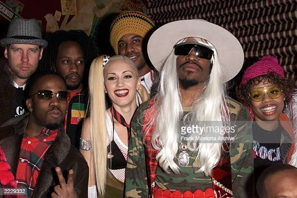 Gwen Stefani of No Doubt and Andre 3000 of Outkast backstage at the MTV Mardi Gras 2002 celebration in New Orleans La 2/5/02 Photo by Frank...