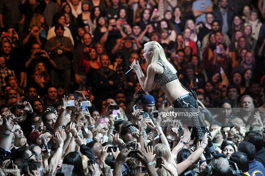 Gwen Stefani of No Doubt crowd-surfs while performing at the KROQ Acoustic Xmas show at Gibson Amphitheatre on December 9, 2012 in Universal City, California.