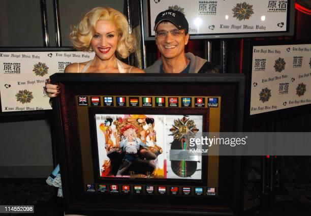 Gwen Stefani with multiplatinum sales award for album 'Love Angel Music Baby' and IGA's Jimmy Iovine