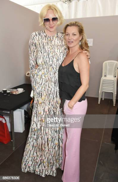 Gwendoline Christie and Kate Moss pose backstage at the Fashion for Relief event during the 70th annual Cannes Film Festival at Aeroport Cannes...