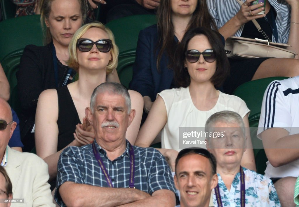 Gwendoline Christie and Michelle Dockery attend the Martin Klizan v Rafael Nadal match on centre court during day two of the Wimbledon Championships at Wimbledon on June 24, 2014 in London, England.
