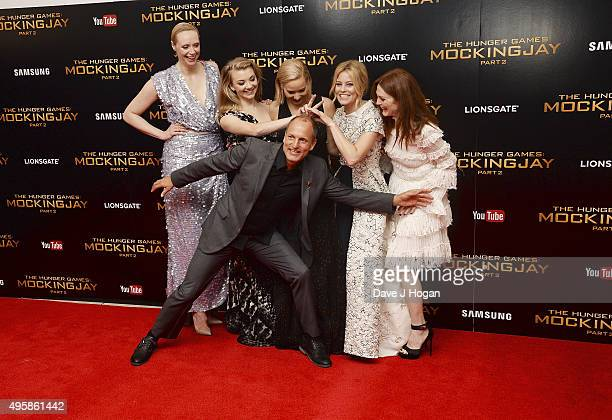 Gwendoline Christie Natalie Dormer Jennifer Lawrence Woody Harrelson Elizabeth Banks and Julianne Moore attend The Hunger Games Mockingjay Part 2 UK...