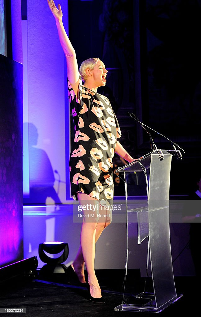 Gwendoline Christie presents the Accessories & Footwear Designer award onstage at The WGSN Global Fashion Awards at the Victoria & Albert Museum on October 30, 2013 in London, England.