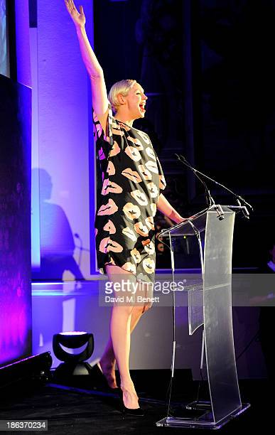 Gwendoline Christie presents the Accessories Footwear Designer award onstage at The WGSN Global Fashion Awards at the Victoria Albert Museum on...