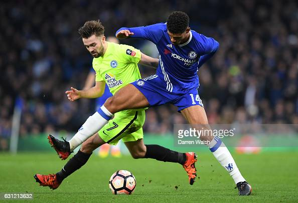 Gwion Edwards of Peterborough United and Ruben LoftusCheek of Chelsea battle for possession during The Emirates FA Cup Third Round match between...
