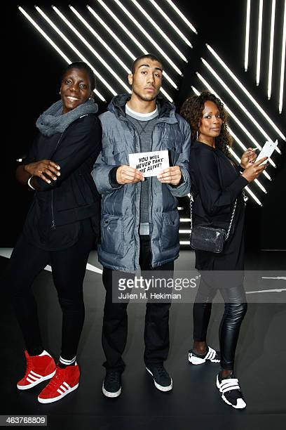 Gwladys Epangue Jimmy Vicaut and Laura FlesselColovic attend the Y3 Menswear Fall/Winter 20142015 Show as part of Paris Fashion Week on January 19...