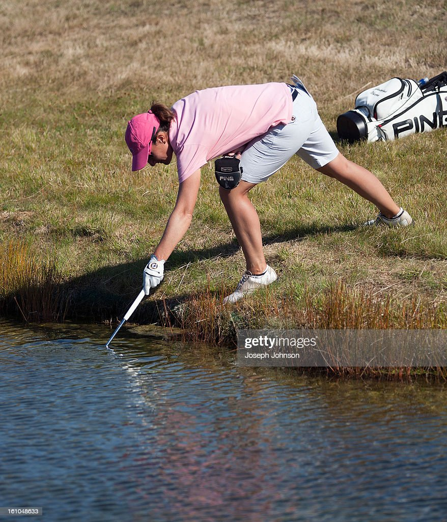 Gwladys Nocera of France retrieves her ball from the water in the 6th hole during day two of the New Zealand women's golf open at Clearwater Golf Course on February 9, 2013 in Christchurch, New Zealand.