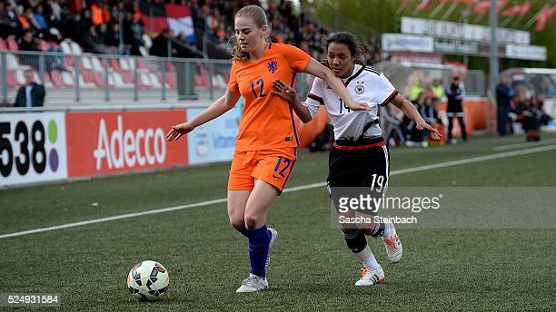 Gwyneth Hendriks of Netherlands is challenged by Gia Corley of Germany during the U17 Girl's international friendly match between Netherlands and...