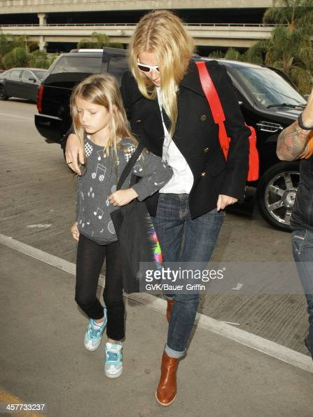 Gwyneth Paltrow and Apple Martin are seen at LAX airport on December 18 2013 in Los Angeles California