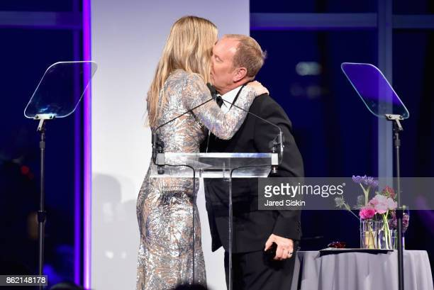 Gwyneth Paltrow and Michael Kors embrace onstage at The 11th Annual Golden Heart Awards benefiting God's Love We Deliver at Spring Studios on October...