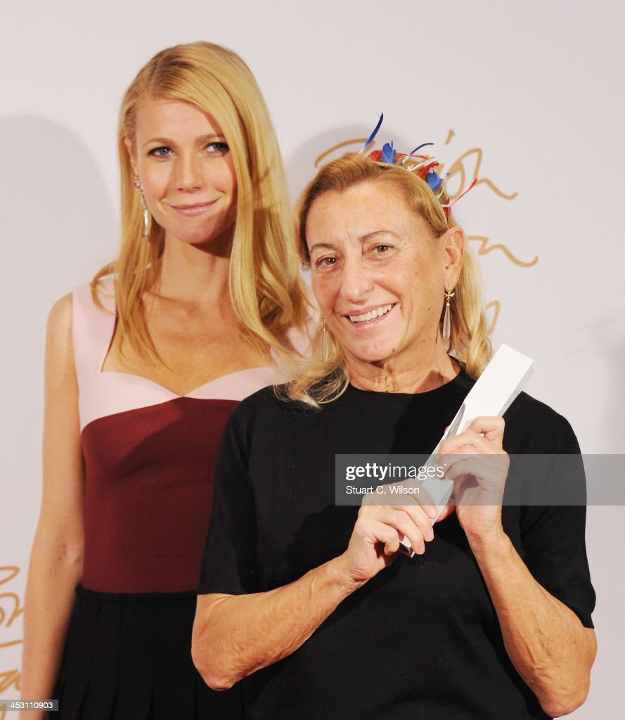 Gwyneth Paltrow and Miuccia Prada with the award for International Designer of the Year pose in the winners room at the British Fashion Awards 2013 at London Coliseum on December 2, 2013 in London, England.