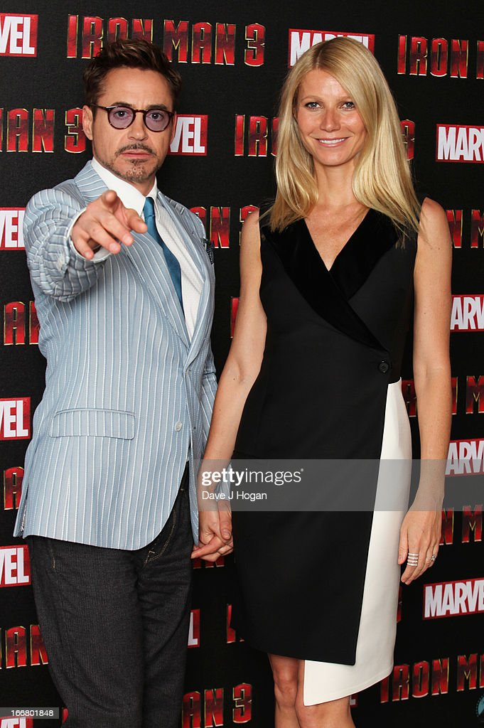 Gwyneth Paltrow and Robert Downey Jr attend a photocall for 'Iron Man 3' at The Dorchester Hotel on April 17, 2013 in London, England.