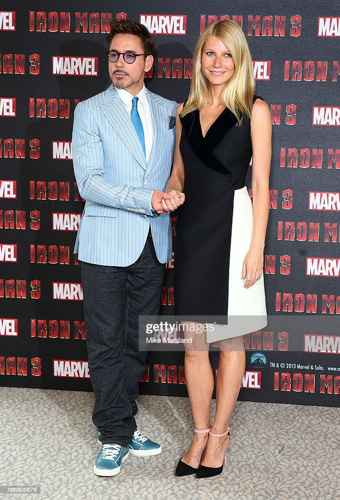 Gwyneth Paltrow and Robert Downey Jr attend the Iron Man 3 photocall at The Dorchester on April 17, 2013 in London, England.