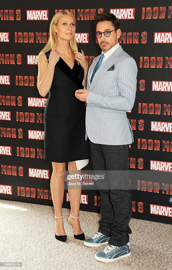Gwyneth Paltrow (L) and Robert Downey Jr pose at the Iron Man 3 photocall at The Dorchester on April 17, 2013 in London, England.