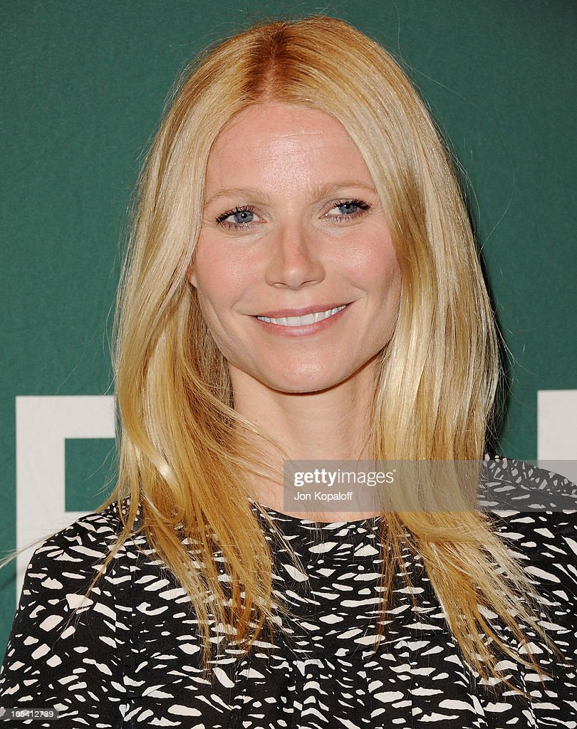 Gwyneth Paltrow poses with her book at Gwyneth Paltrow Signs Copies Of Her New Book 'It's All Good: Delicious, Easy Recipes That Will Make You Look Good and Feel Great' at Barnes & Noble bookstore at The Grove on April 3, 2013 in Los Angeles, California.