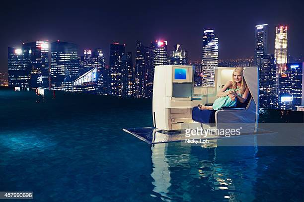 Gwyneth Paltrow relaxes on a British Airways Club World seat suspended on the surface of the Infinity Pool on the roof of the Marina Bay Sands Hotel...