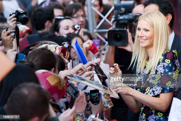 Gwyneth Paltrow signs autographs for fans as she arrives to the premiere of 'Iron Man 3' at Le Grand Rex on April 11 2013 in Paris France