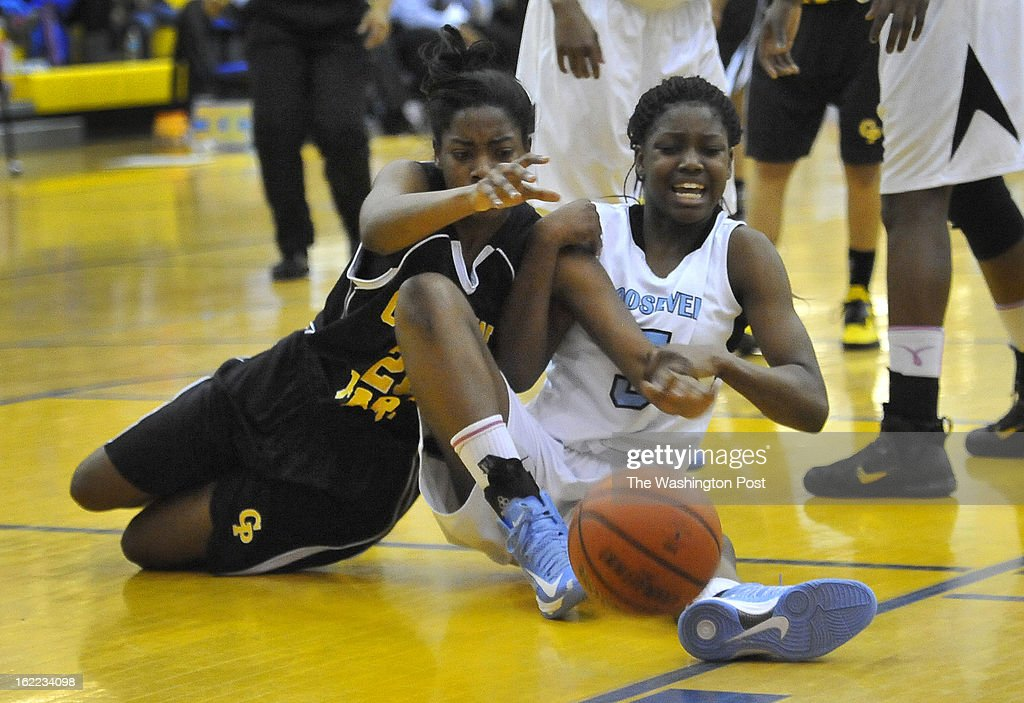 Gwynn Park's Ashleigh Seegars and Roosevelt's Kaila Charles go to the fllor chasing a rebound in the Prince George's County championship game at Wise high school on Wednesday, February 20, 2013 in Upper Marlboro, Md.