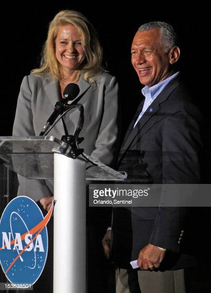 Gwynne Shotwell left president of SpaceX and Charles Bolden NASA administratorsmile after Falcon 9 rocket carrying a Dragon blasts off Sunday October...