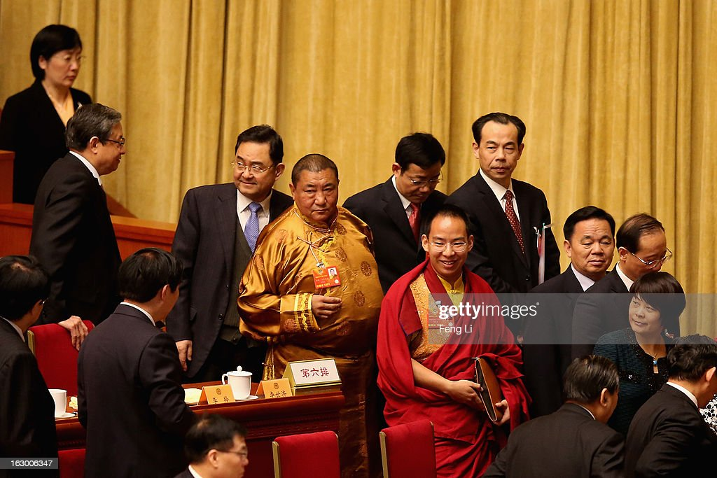 Gyaltsen Norbu, the Chinese government-appointed 11th Panchen Lama (in red clothes) and delegates leave after the opening session of the Chinese People's Political Consultative Conference in Beijing's Great Hall of the People on March 3, 2013 in Beijing, China. Over 2,000 members of the 12th National Committee of the Chinese People's Political Consultative, a political advisory body, are attending the annual session, during which they will discuss the development of China.