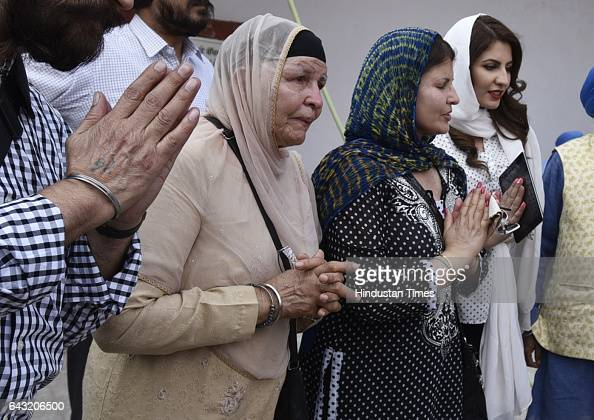 Gyan Kaur with her daughter Sarvjit Kaur and Grand daughter Sara Kaur from Canda breaks down on while watching installation of the latters statue at...
