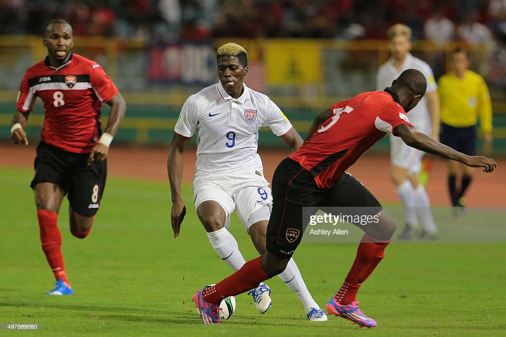Gyasi Zades runs past Neveal Hackshaw as Khaleem Hyland looks on during a World Cup Qualifier between Trinidad and Tobago and USA as part of the FIFA...