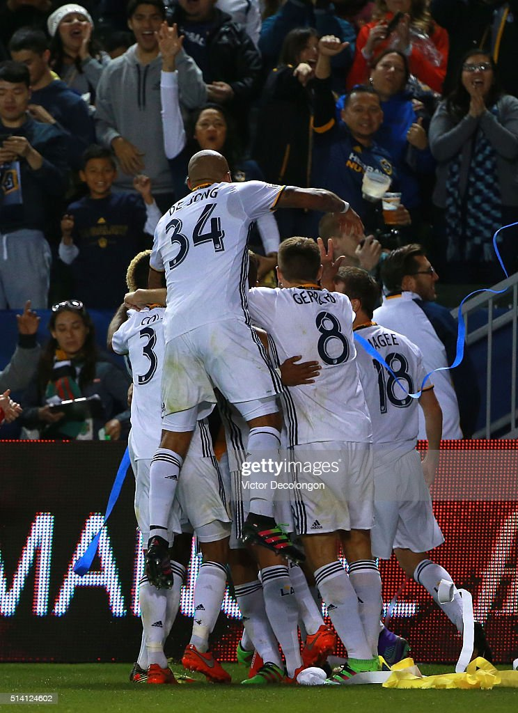 Gyasi Zardes Ashley Cole Nigel de Jong Steven Gerrard and Mike Magee of Los Angeles Galaxy mob teammate Daniel Steres after Steres scored on a header...