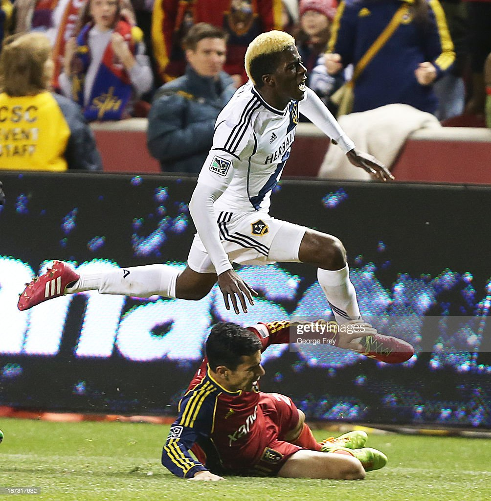 Gyasi Zardes Los Angeles Galaxy jumps over Tony Beltran of Real Salt Lake during the second half of an Western Conference Semifinals MLS soccer game...