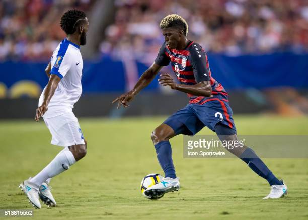 Gyasi Zardes maneuvers around Martinique player during the CONCACAF Gold Cup soccer match between USA and Martinique on July 12 2017 at Raymond James...