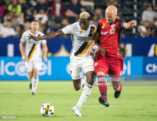 Gyasi Zardes of Los Angeles Galaxy battles Michael Bradley of Toronto FC during the Los Angeles Galaxy's MLS match against Toronto FC at the StubHub...