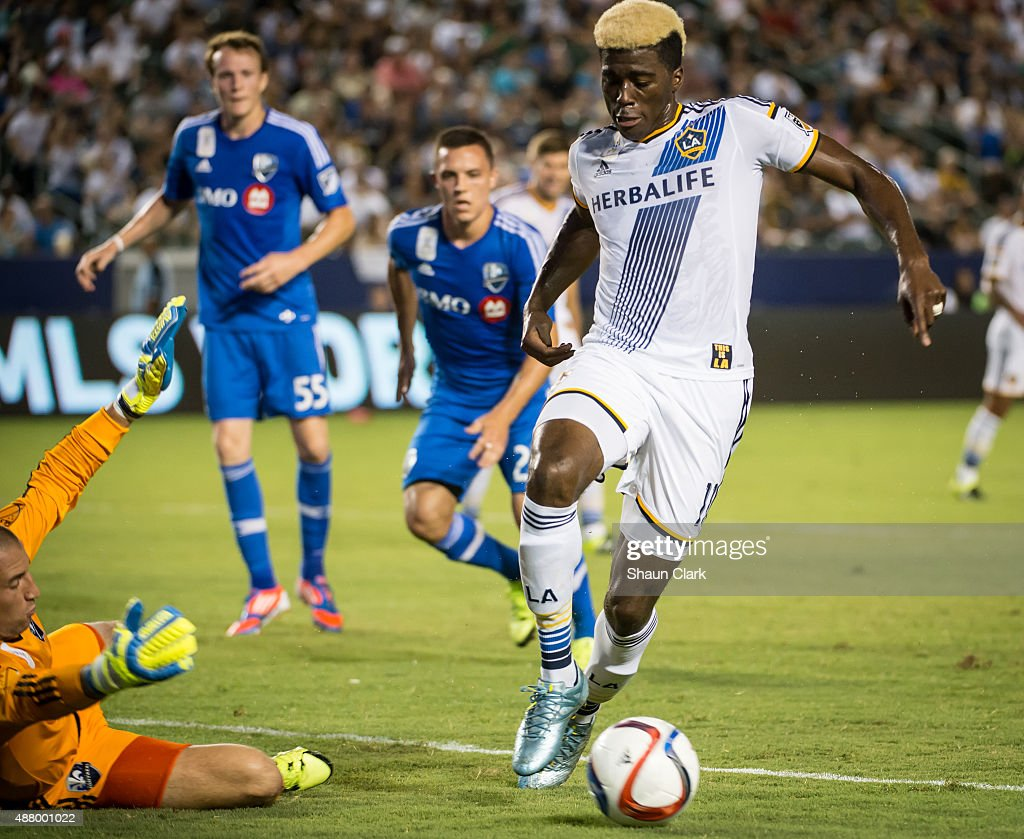 Gyasi Zardes #11 of Los Angeles Galaxy goes around Evan Bush #1 of Montreal Impact during Los Angeles Galaxy's MLS match against Montreal Impact at the StubHub Center on September 12, 2015 in Carson, California. The match ended in 0-0 tie