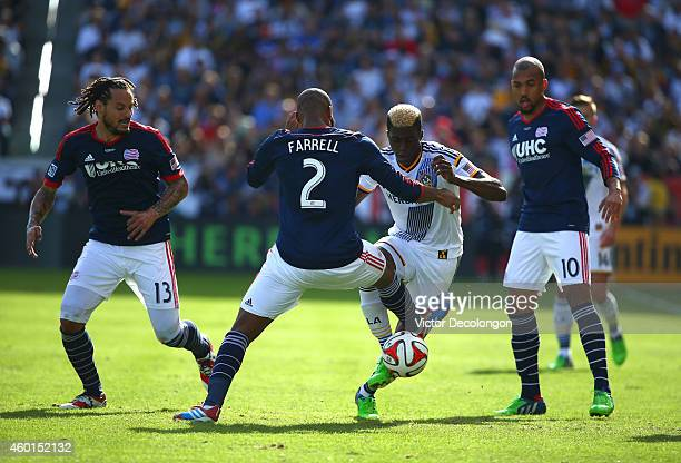 Gyasi Zardes of the Los Angeles Galaxy and Andrew Farrell of the New England Revolution vie for the ball as Jermaine Jones and Teal Bunbury of the...