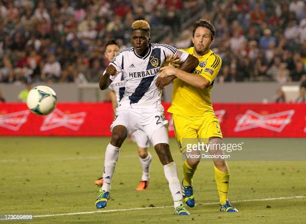 Gyasi Zardes of the Los Angeles Galaxy and Danny O'Rourke of the Columbus Crew vie for the ball in the second half of their MLS match at StubHub...