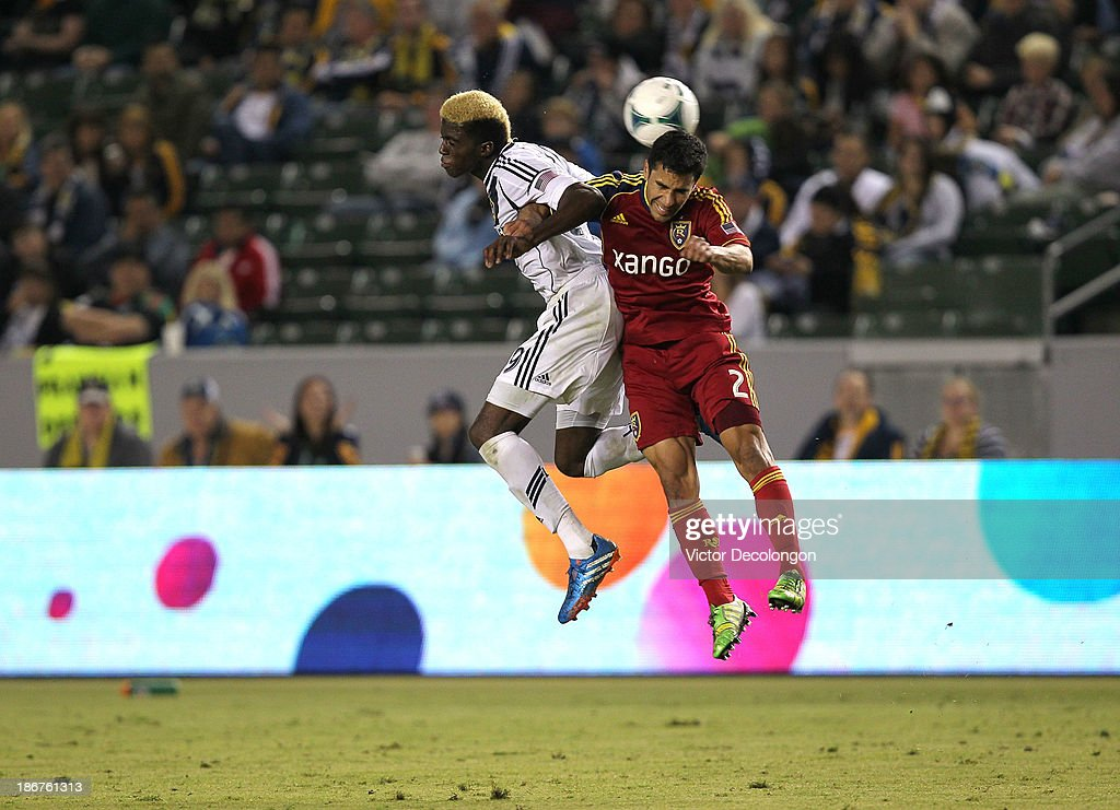 Gyasi Zardes of the Los Angeles Galaxy and Tony Beltran of Real Salt Lake vie for a high ball in the second half of their MLS match at StubHub Center...