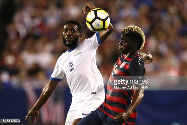 Gyasi Zardes of the United States competes with Nicolas Zaire of Martinique during the 2017 CONCACAF Gold Cup Group B match between the United States...