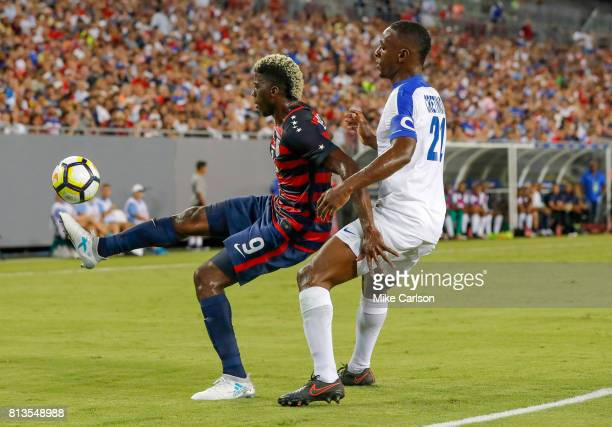 Gyasi Zardes of the United States controls the ball against Sebastien Cretinoir of Martinique during the first half of the CONCACAF Group B match at...