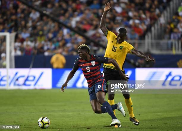 Gyasi Zardes of the USA and JeVaughn Watson of Jamaica vie for the ball during the final football game of the 2017 CONCACAF Gold Cup at the Levi's...