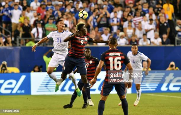 Gyasi Zardes of the USA battles against Bryan Tamacas of El Salvador during their CONCACAF Gold Cup quarterfinal match at Lincoln Financial Field on...