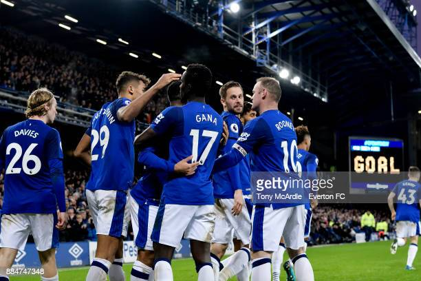 Gylfi Sigurdsson celebrates his goal with team mates during the Premier League match between Everton and Huddersfield Town at Goodison Park on...