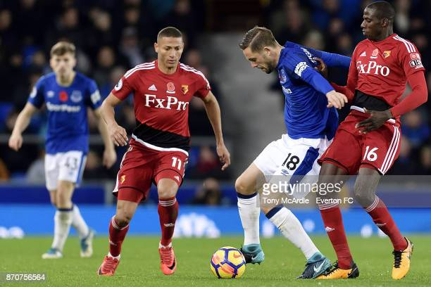 Gylfi Sigurdsson of Everton and Abdoulaye Doucoure challenge for the ball during the Premier League match between Everton and Watford at Goodison...