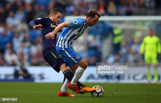 Gylfi Sigurdsson of Everton and Dale Stephens of Brighton and Hove Albion during the Premier League match between Brighton and Hove Albion and...