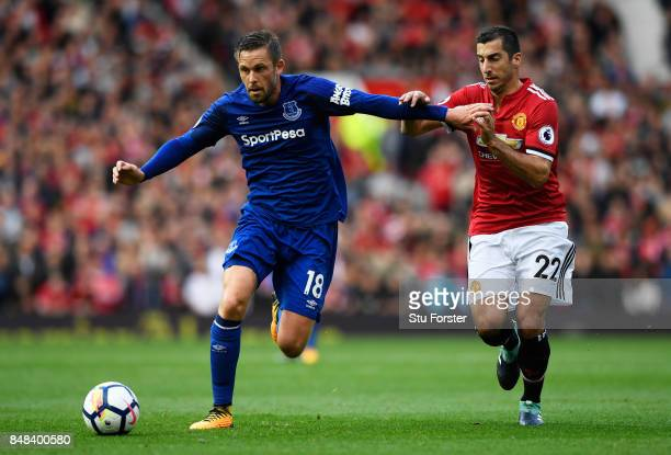 Gylfi Sigurdsson of Everton and Henrikh Mkhitaryan of Manchester United battle for possession during the Premier League match between Manchester...