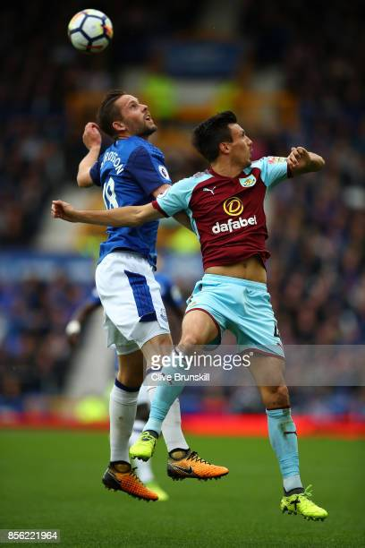 Gylfi Sigurdsson of Everton and Jack Cork of Burnley battle for possession in the air during the Premier League match between Everton and Burnley at...