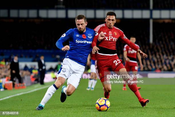 Gylfi Sigurdsson of Everton and Jose Holebas challenge for the ball during the Premier League match between Everton and Watford at Goodison Park on...